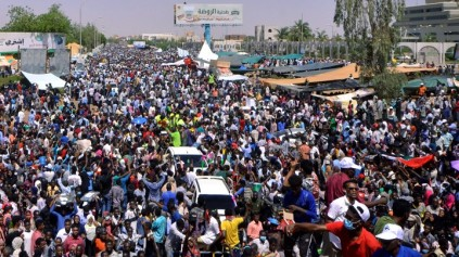 Sudanese demonstrators chant slogans during a protest demanding Sudanese President Omar Al-Bashir to step down outside the defence ministry in Khartoum