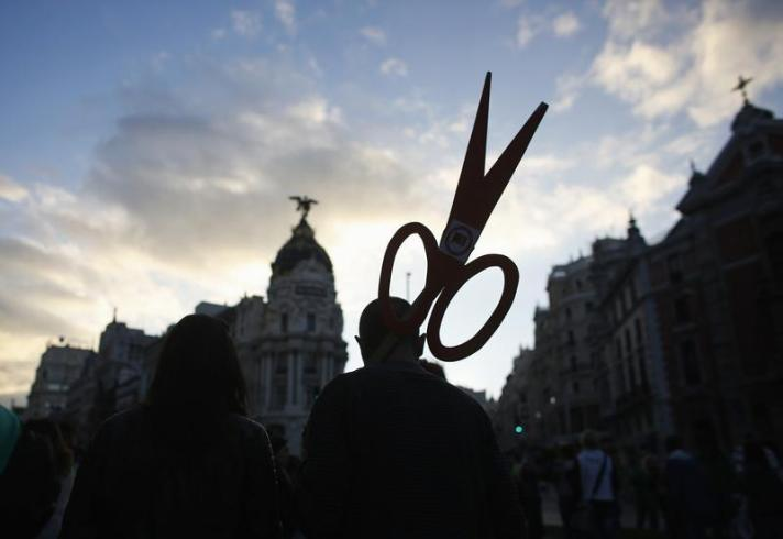 Demonstrators take part in a protest against government spending cuts in education during a nationwide education sector strike in Madrid
